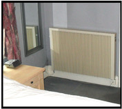 Picture of a radiator in a bedroom